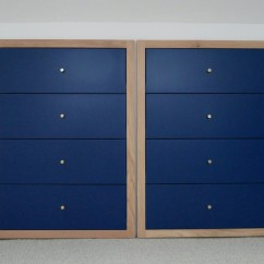 Drawer units built into the eaves of a house. Additional storage accessed by doors to the left and right of these drawers.