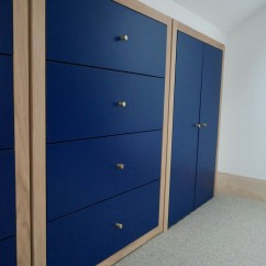 Oak frames set off the contrast between then deep blue and the brass tapered knobs.